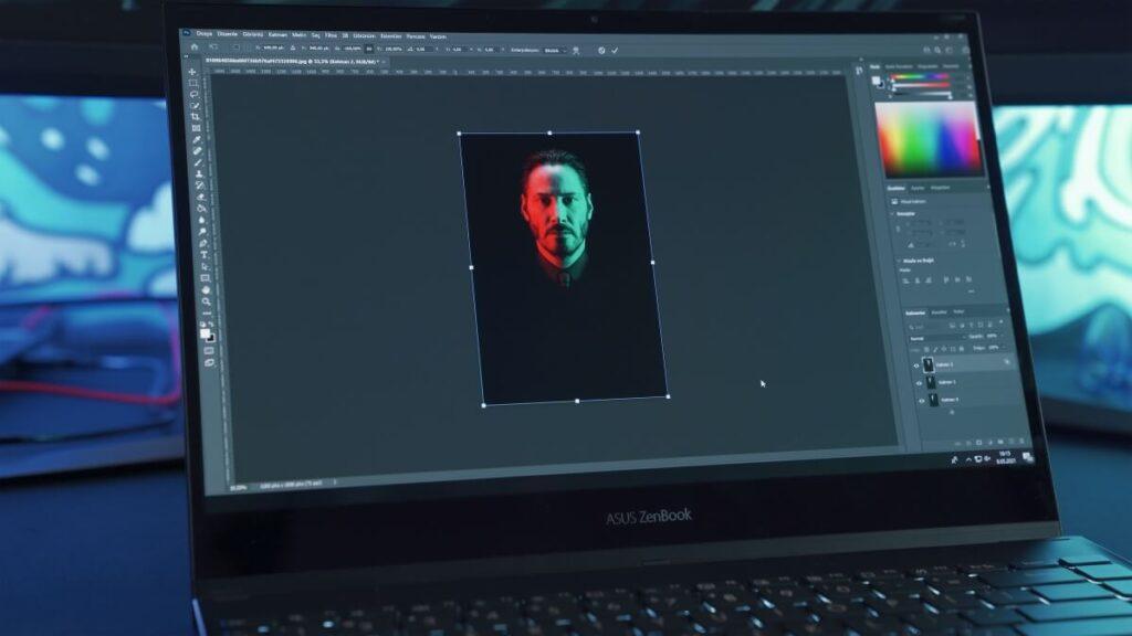 A photo editor color correcting a photo on Photoshop